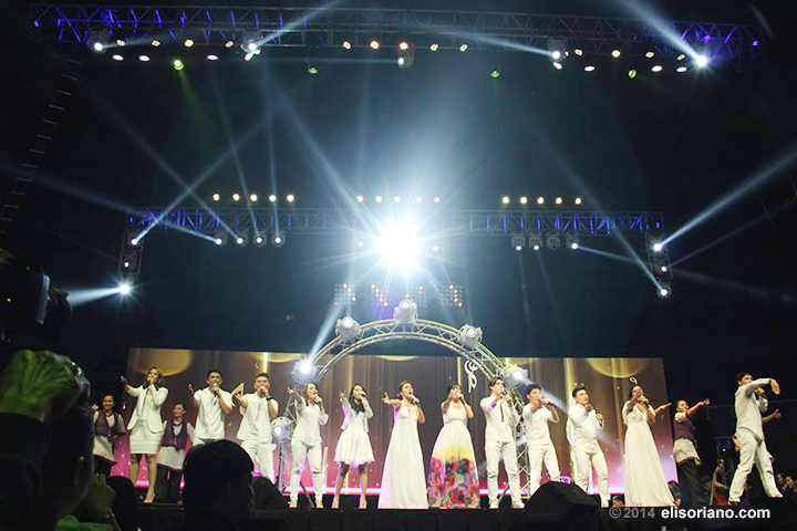 """The interpreters of the twelve new praise songs of ASOP Music Festival grace the Smart-Araneta Colesium stage as they perform  the program's theme song, """"Enrich the Spirit (Inspired by Music)"""