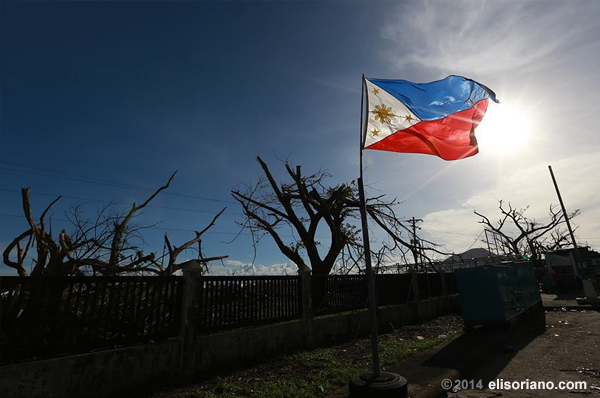 A Philippine flag stands amid the Yolanda-devastated Tacloban City, symbolizing the hope that still remains among the affected Filipino families (File photo: Rovic Balunsay, Photoville International)