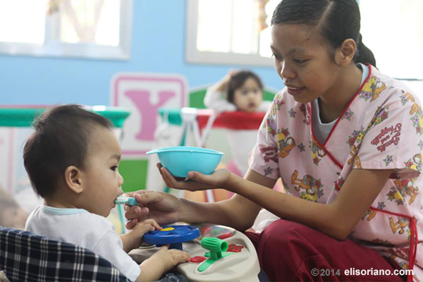 Volunteer staff and social workers nurture and provide the basic needs of the babies and children sheltered by the Infant Care Center (Photo by Rodel Lumiares, Photoville International)